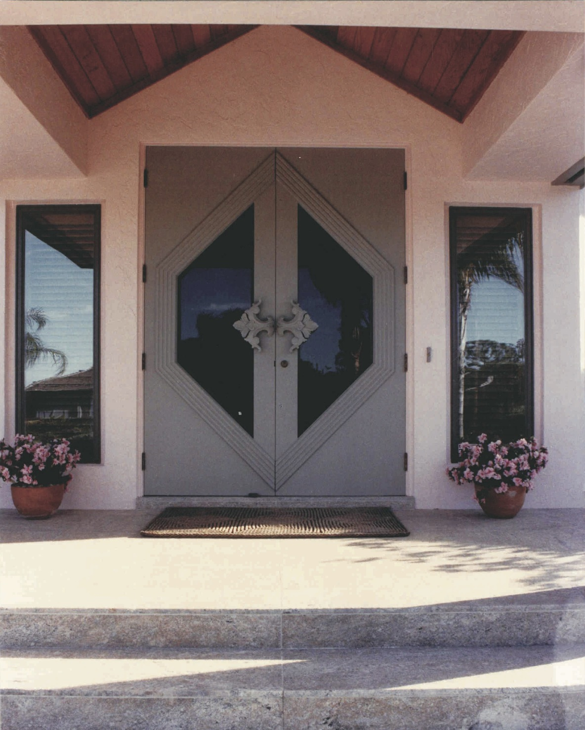 Ash entry system with hand-carved pulls - Pipers Landing, Palm City