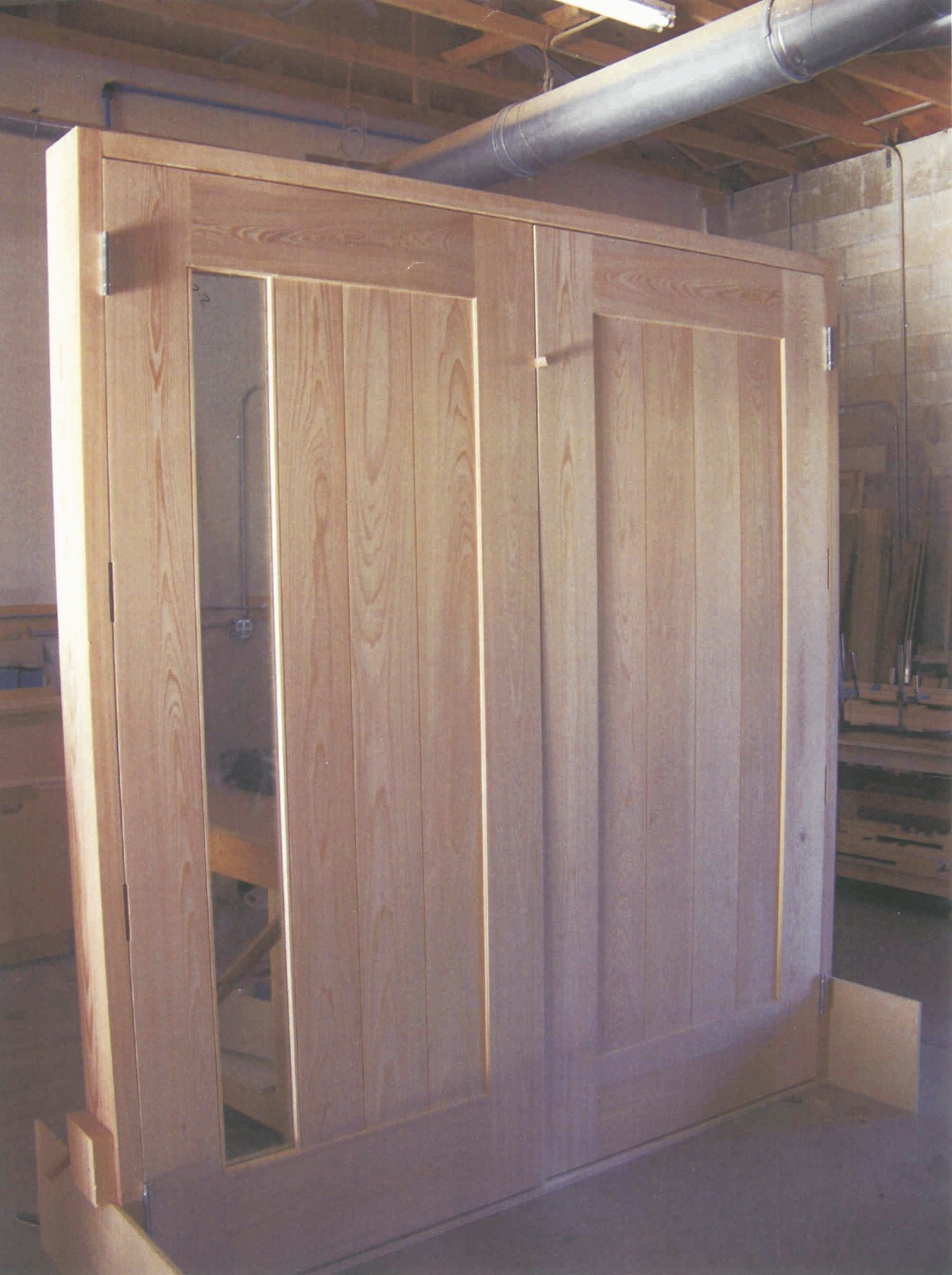 Cypress door system with one glass pane, in process -<br />Nassau, Bahamas